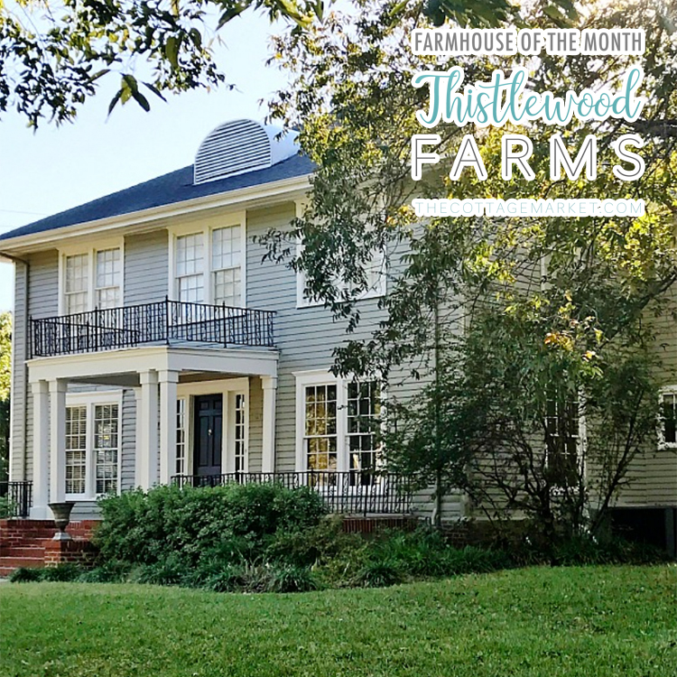 This charming farmhouse has a beautiful balcony and large yard.