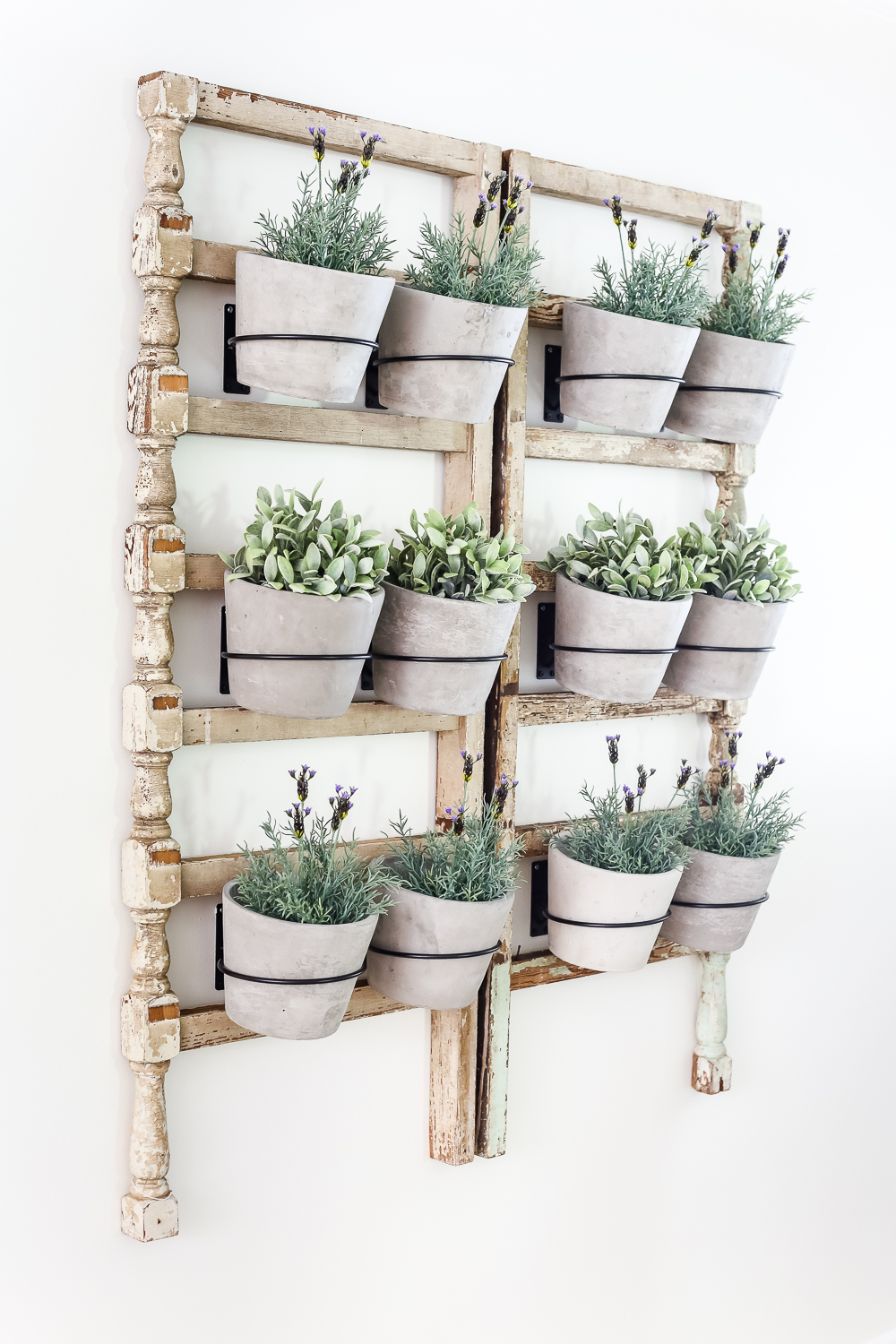 These hanging wall planters add a bohemian feel to this farmhouse space.