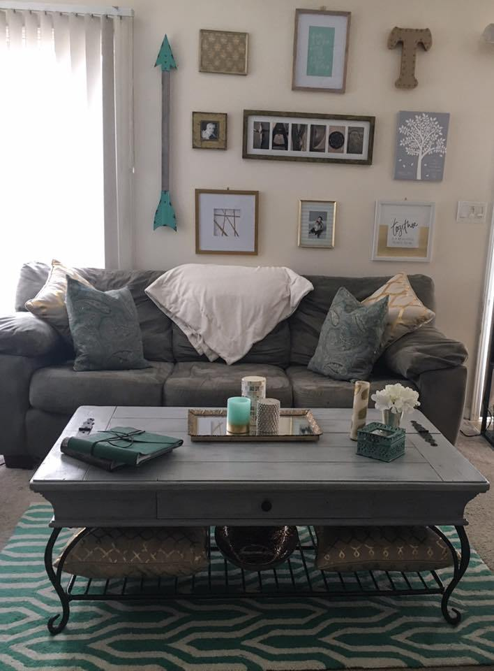 This gray tones in this cohesive living room compliment the turquoise rug and decor.