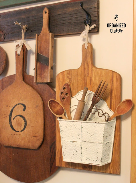 This unique cutting board DIY craft project makes for a great utensil organizer.