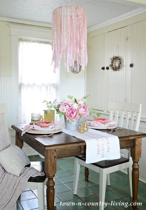 This ribbon chandelier looks great with this elegant tablescape for two