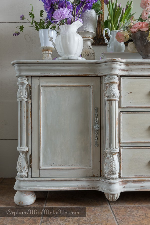 This refurbished dresser looks amazing with a whitewashed distressed paint for a classic vintage look