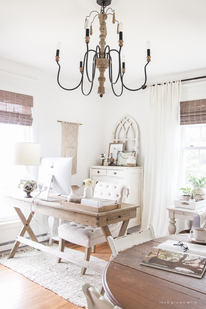 This farmhouse workhorse style desk is a lovely workspace in a stylish living room