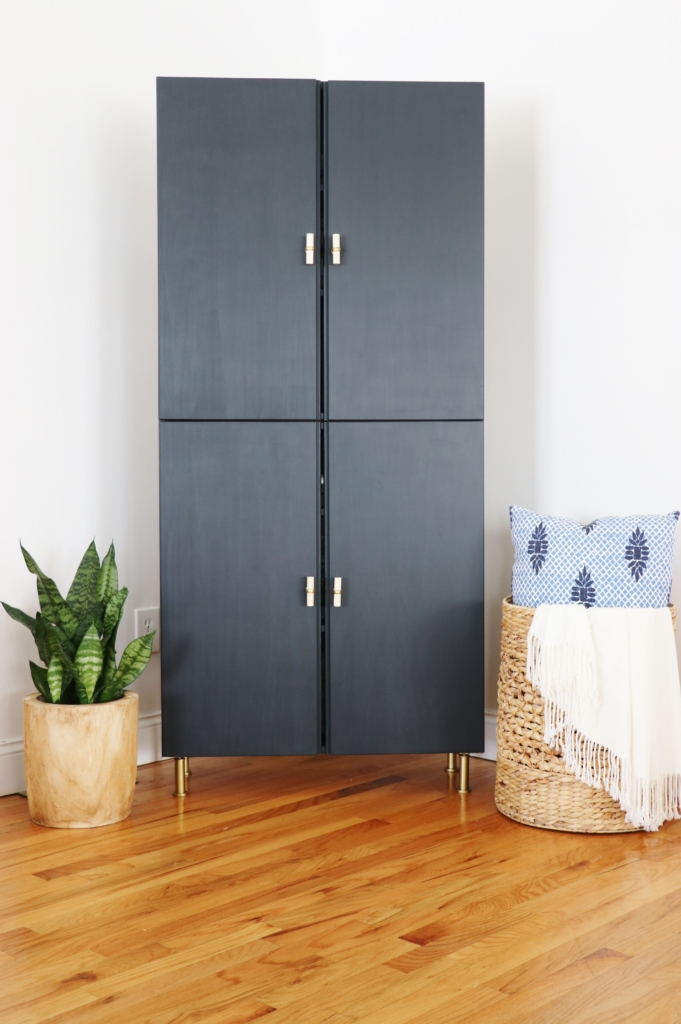 This IKEA library cabinet was painted black and with some added gold hardware is a gorgeous sleek farmhouse armoire
