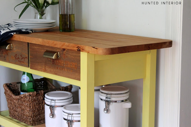 The wooden table top compliments the bright yellow legs and shelves.