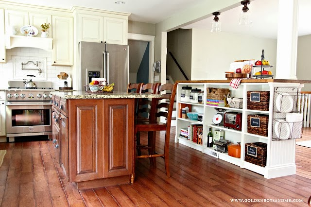 The wooden elements in this classic kitchen compliment the granite counter top.