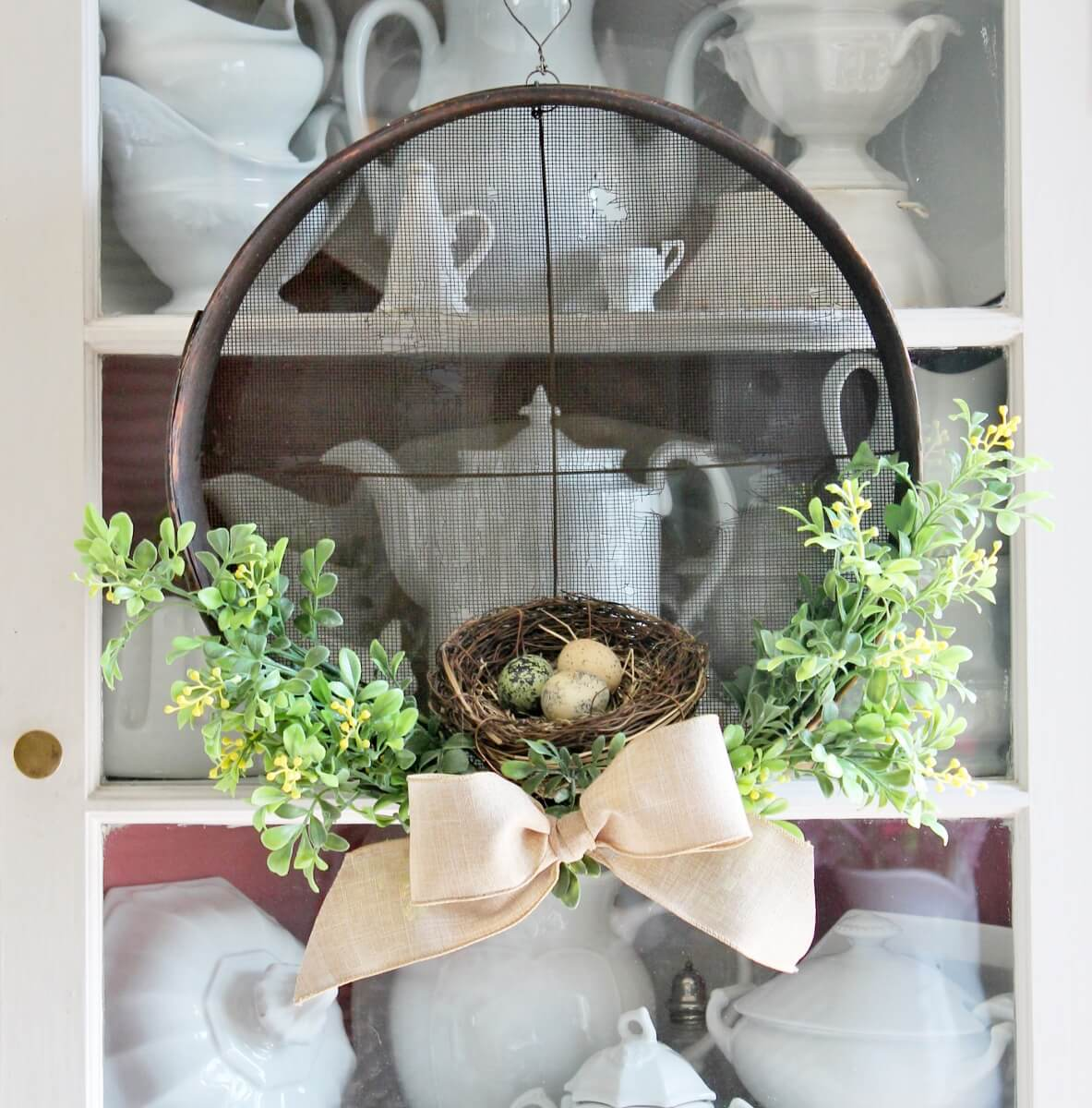 This vintage sieve turned farmhouse style wreath is rustic and fresh for spring.