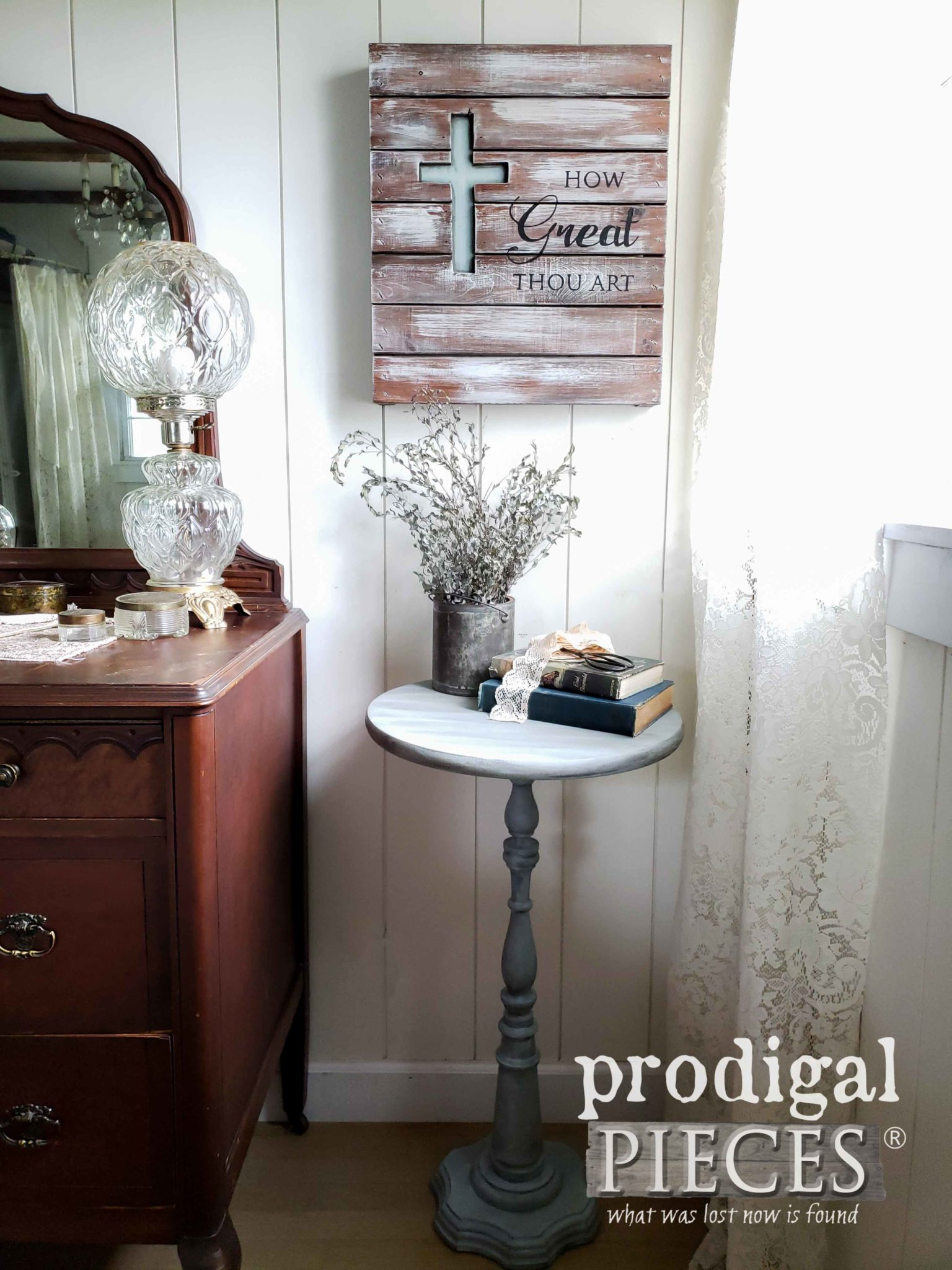 This redone table painted gray pairs well with the dark stained vanity.
