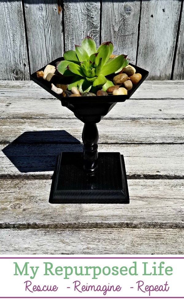This wooden pedestal painted black makes for a great planter.