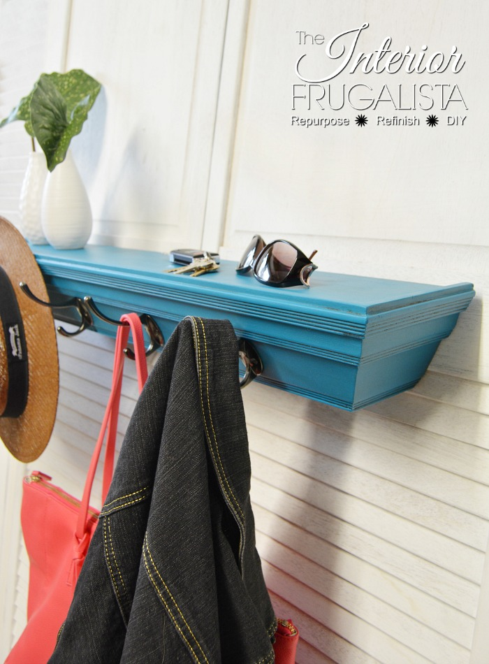this re-purposed shelf painted blue is great for hanging jackets and purses.