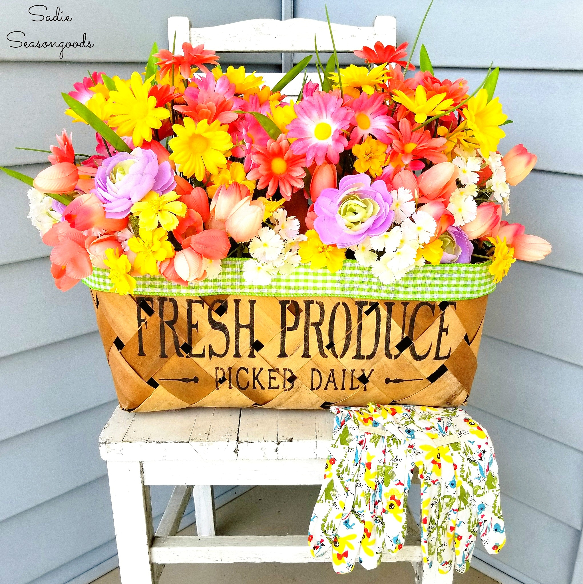 This adorable woven basket with bright flowers adds color to this front porch chair.