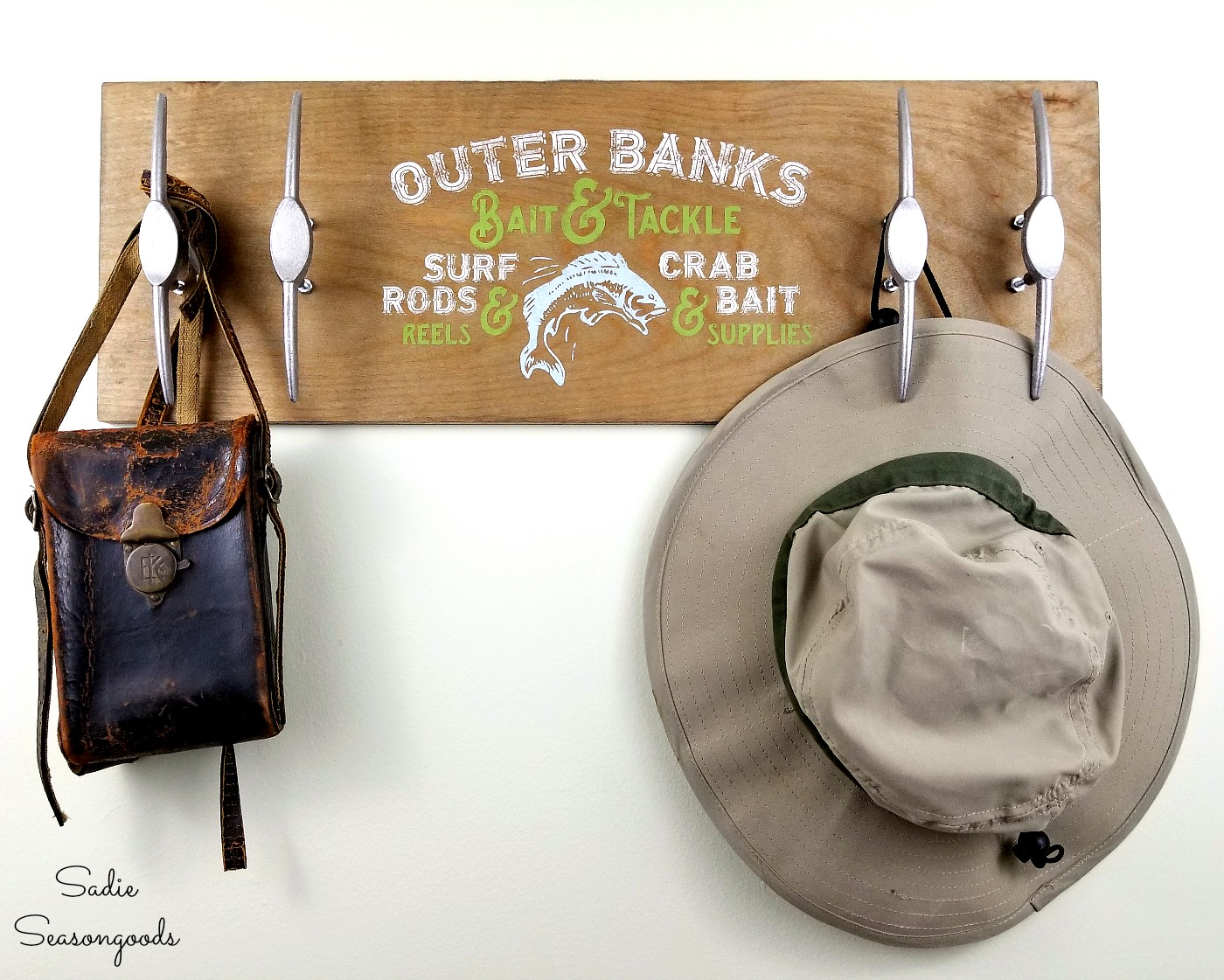 This fishing pallet sign with hooks is great for storing bags and hats.