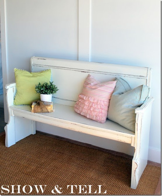 This vintage bench painted white compliments the colorful accent pillows.