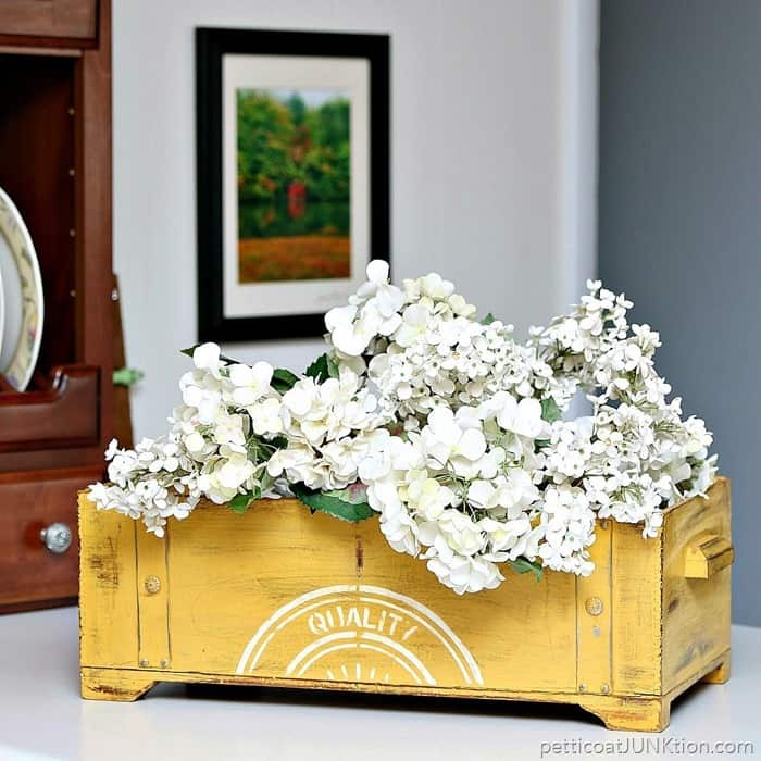 This thrift store chest painted yellow looks great with fresh flowers.