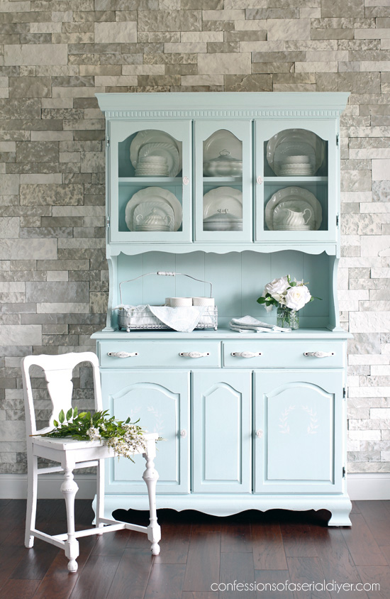 This baby blue dresser is great for storing fine china and compliments the dark wood floors.