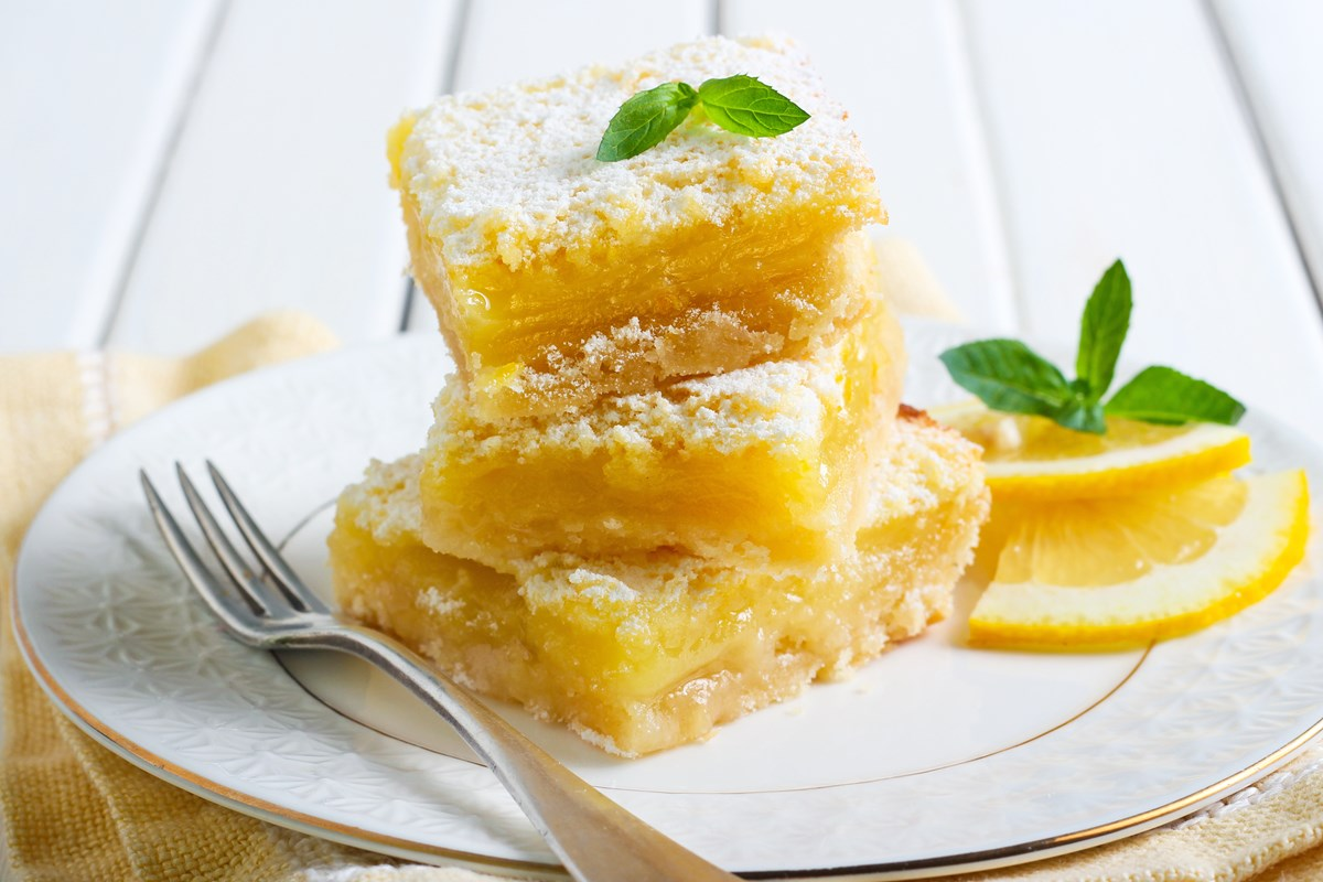 These gooey lemon bars topped with powdered sugar and mint are divine.