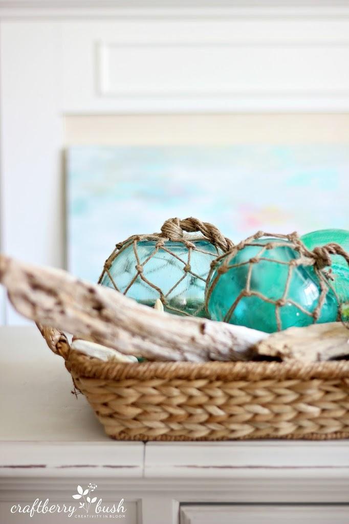 These DIY aqua glass buoys make the perfect coastal centerpieces.