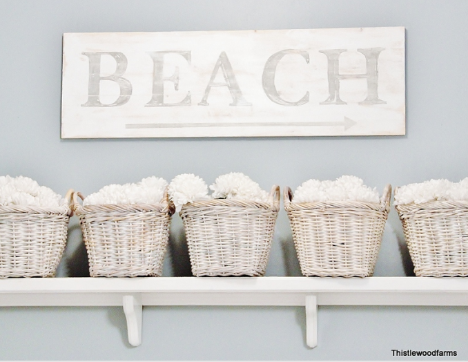 This farmhouse style beach sign adds a coastal element to the space.