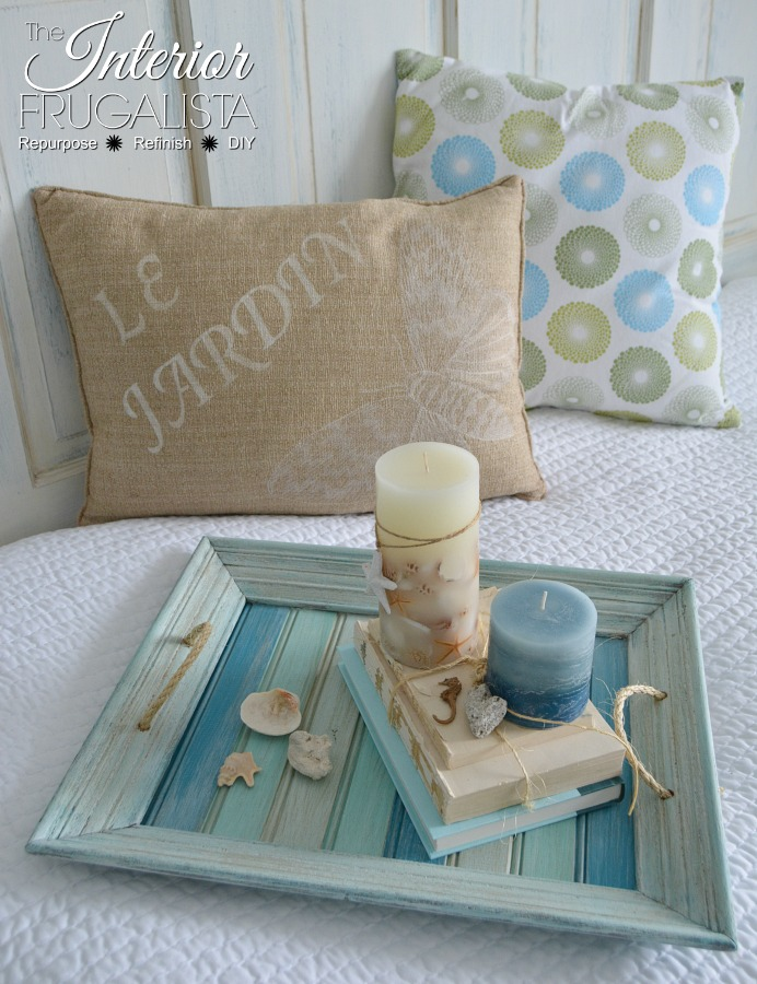 This re-purposed coastal picture frame makes a great serving tray.