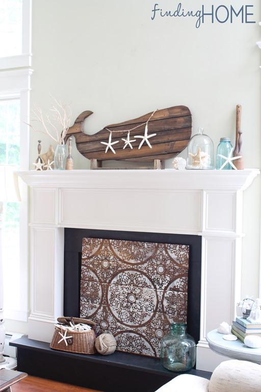 This reclaimed wood turned whale art is the perfect coastal mantel piece.