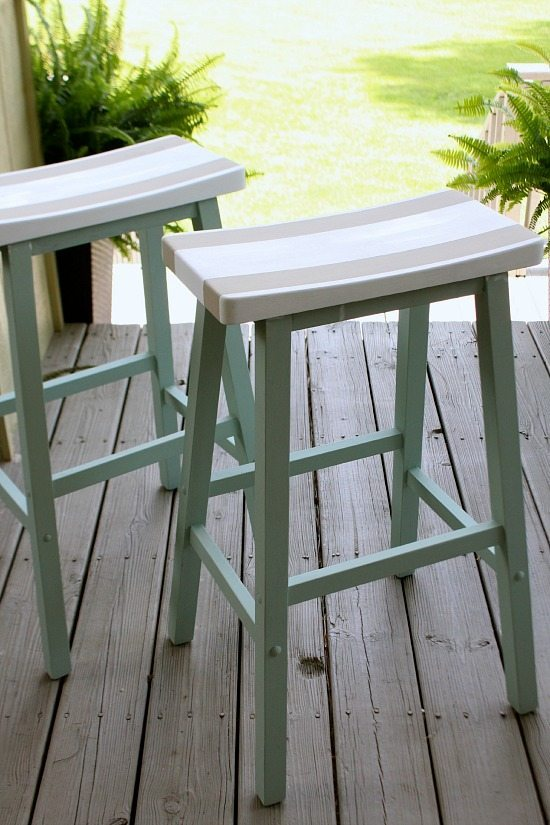 These painted stools with wooden accents are the perfect coastal porch addition.