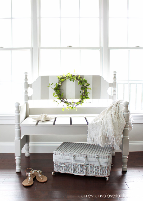 This refinished vintage bench paint neutral with stripes is farmhouse chic.