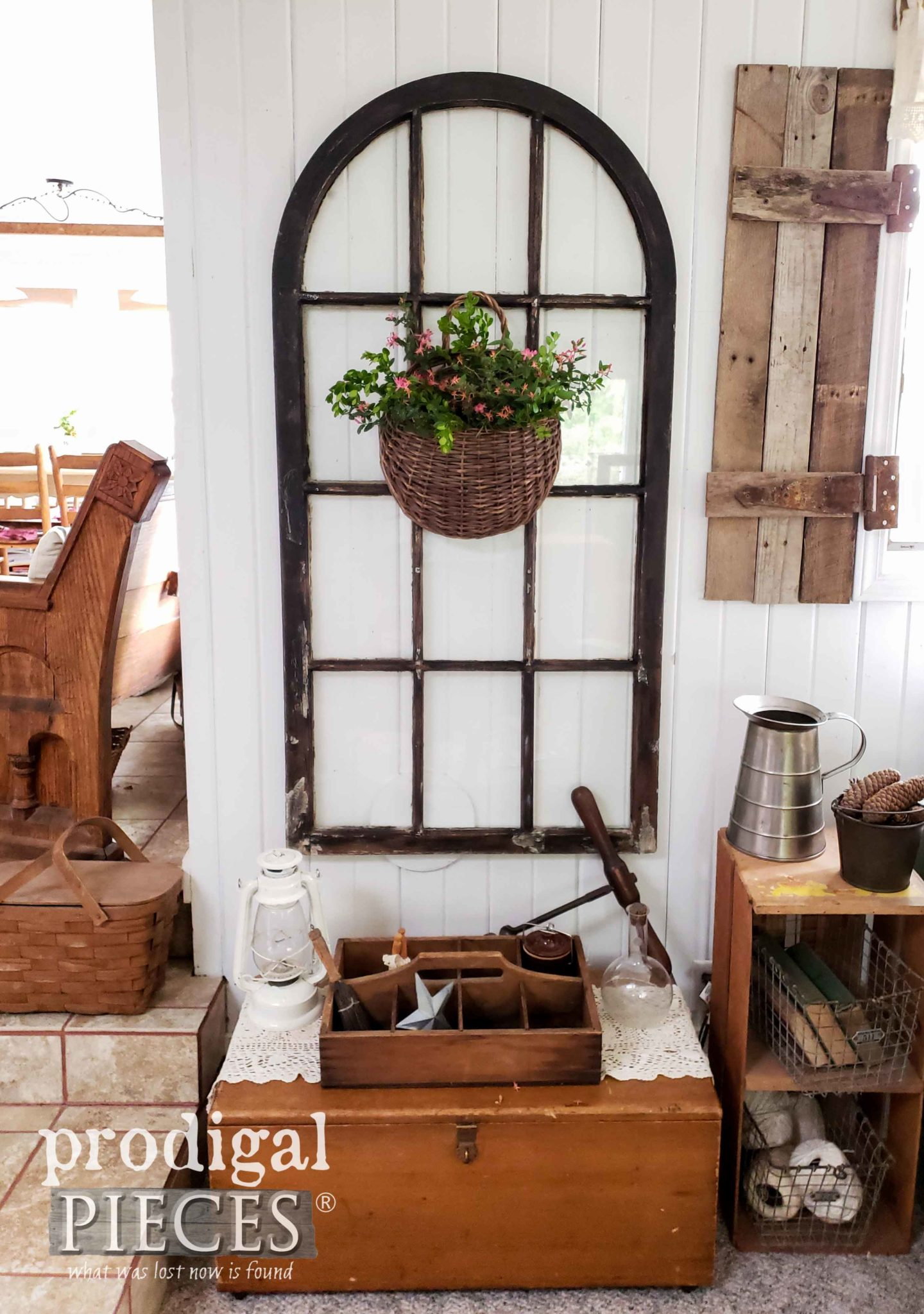 This antique window renovated with fresh flowers is a great farmhouse architectural piece.