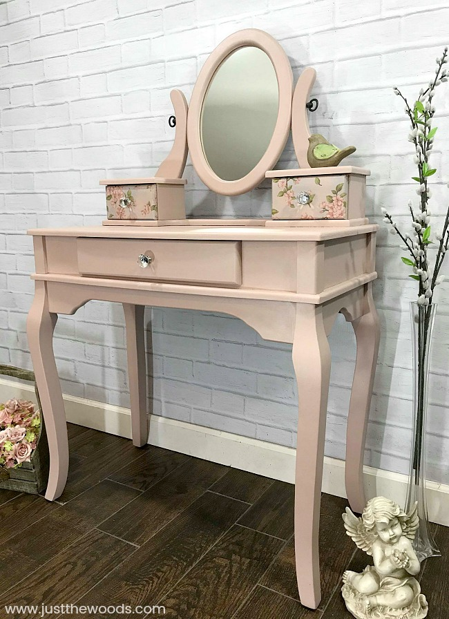 This renovated vanity with blush pink paint and sparkly handles is a gem.