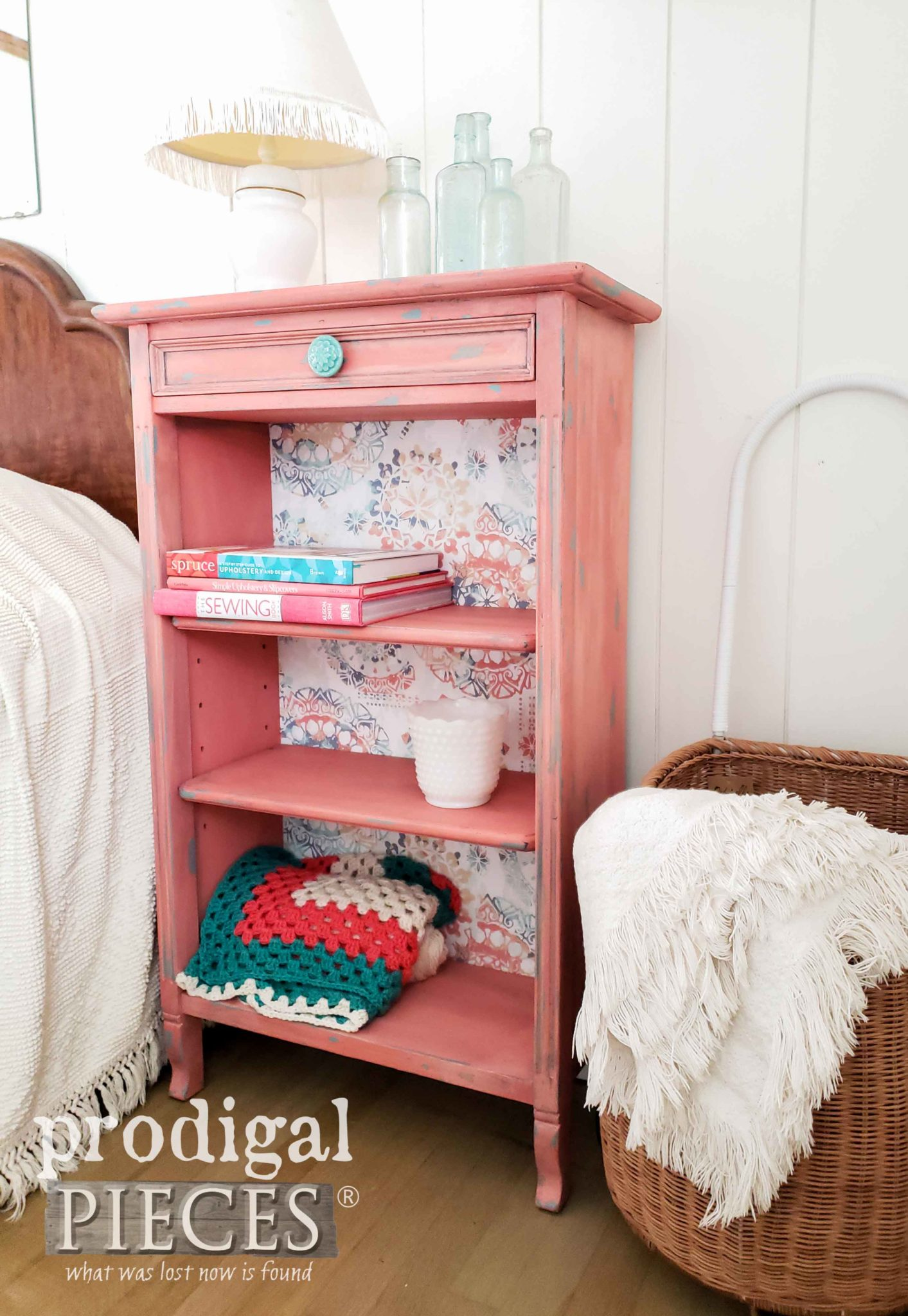 This distressed pink bedside table is quirky and fun.