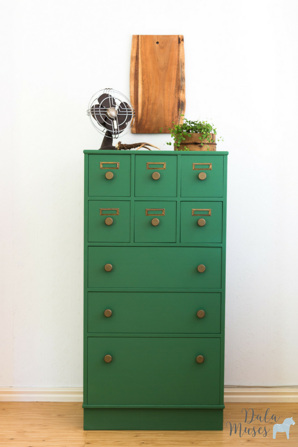 this gorgeous cabinet is the perfect farmhouse style storage with a nice pop of forest green paint