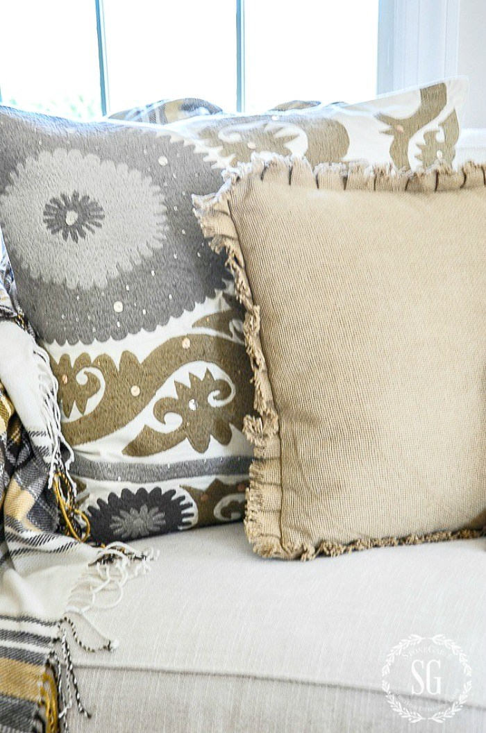 these farmhouse fabric throw pillows are gorgeous on this creme couch