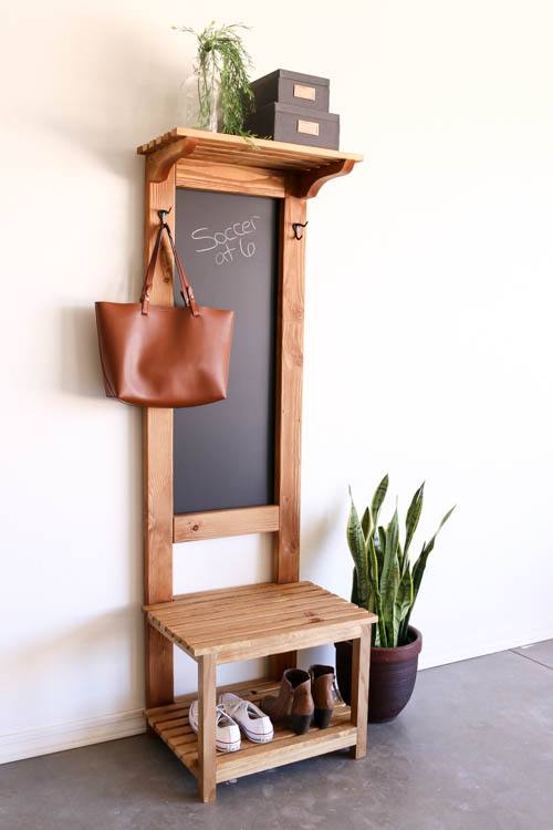 This chalkboard area in the entryway doubles as storage too.