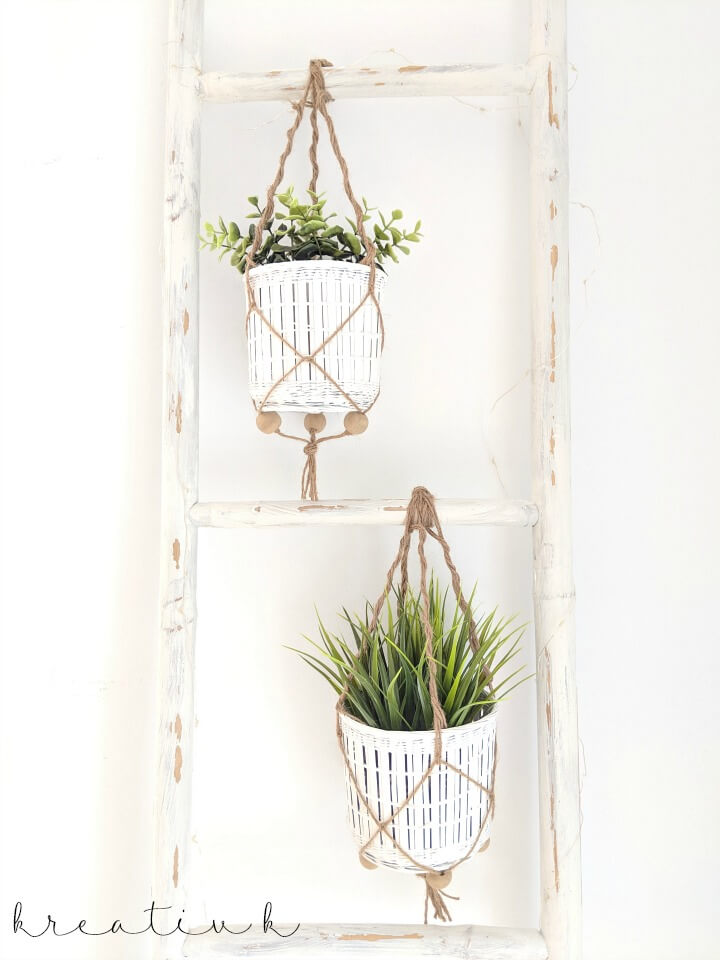 These succulent plants hanging on the vintage white ladder are adorable farmhouse style.