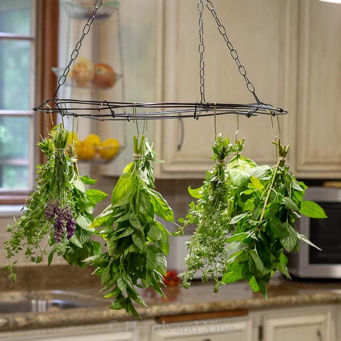 This unique herb drying rack adds to the farmhouse feel in this kitchen.