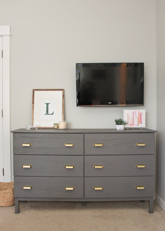 A double Tarva dresser was transformed into a bedroom dresser and entertainment center