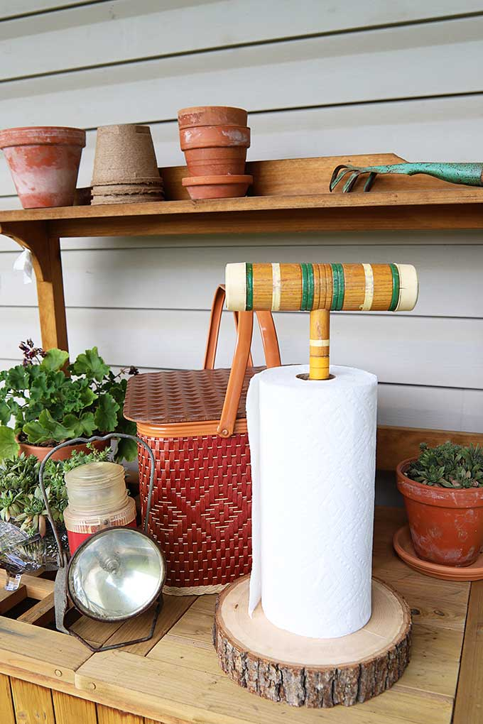 This unique paper towel holder is made from an old Croquet mallet