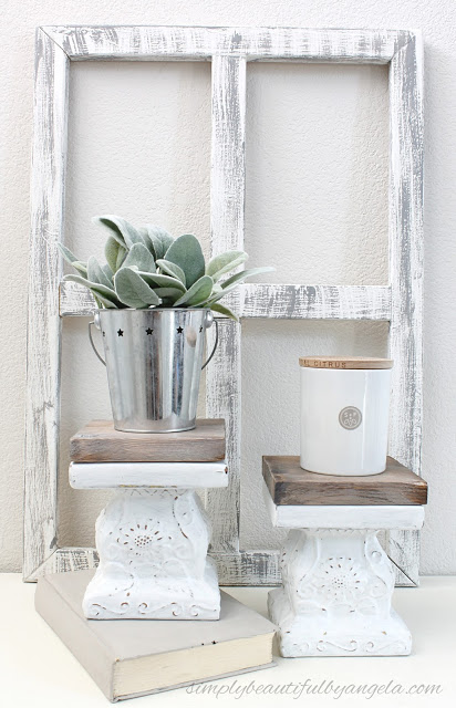 This wooden window frame and pedestals are gorgeous farmhouse style decor picked up from a thrift store