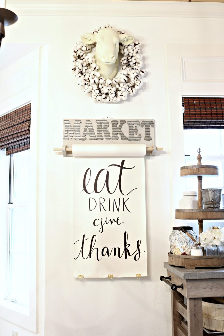 This farmhouse style scroll banner looks amazing in this gorgeous kitchen setting