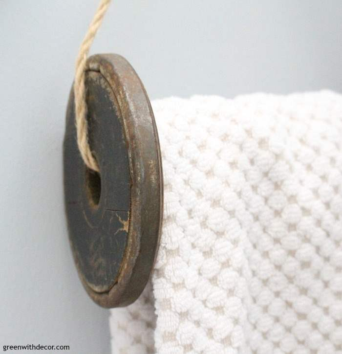 These vintage wooden spools turned into towel holders is a brilliant thrift store makeover