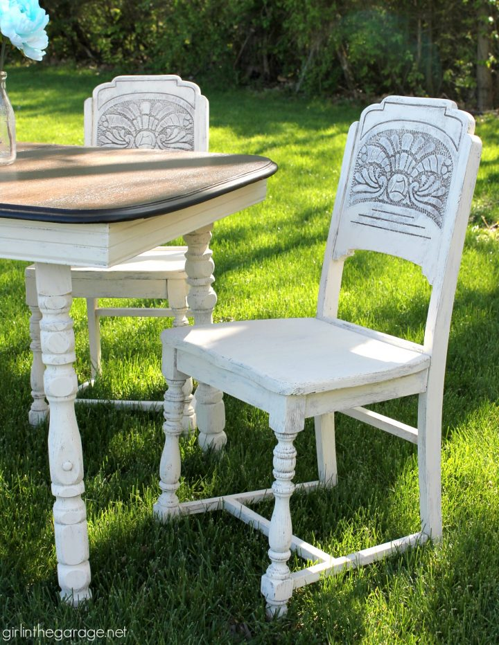 The weathered look of these old chairs makes this set perfect for an outdoor patio
