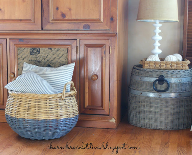 These barrel baskets were made over into chic pillow and blanket holders for the living room