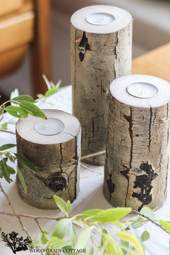 These candle sticks made from wood logs add a rustic farmhouse element.