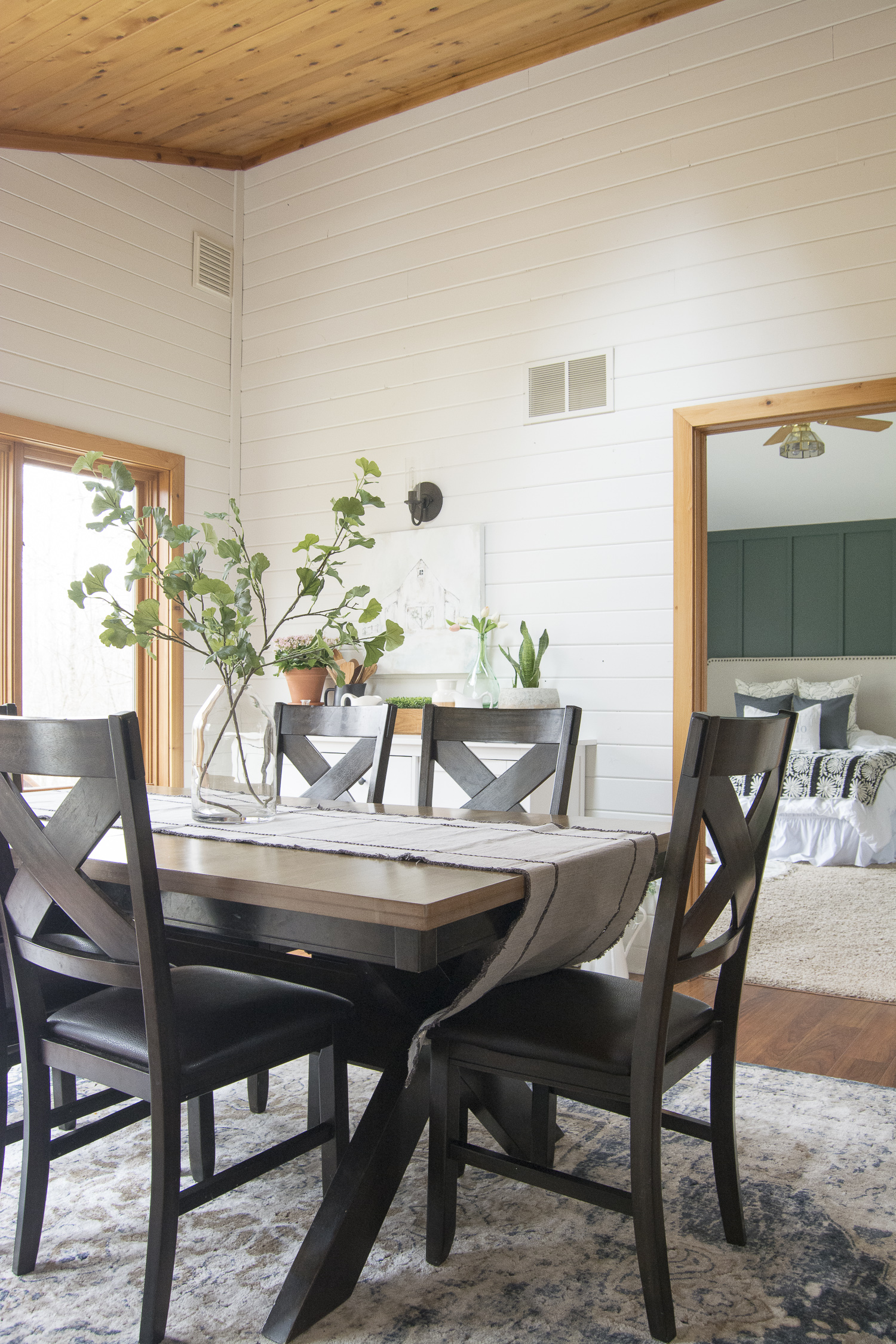The gorgeous DIY barnwood wall makes this dining room a farmhouse dream