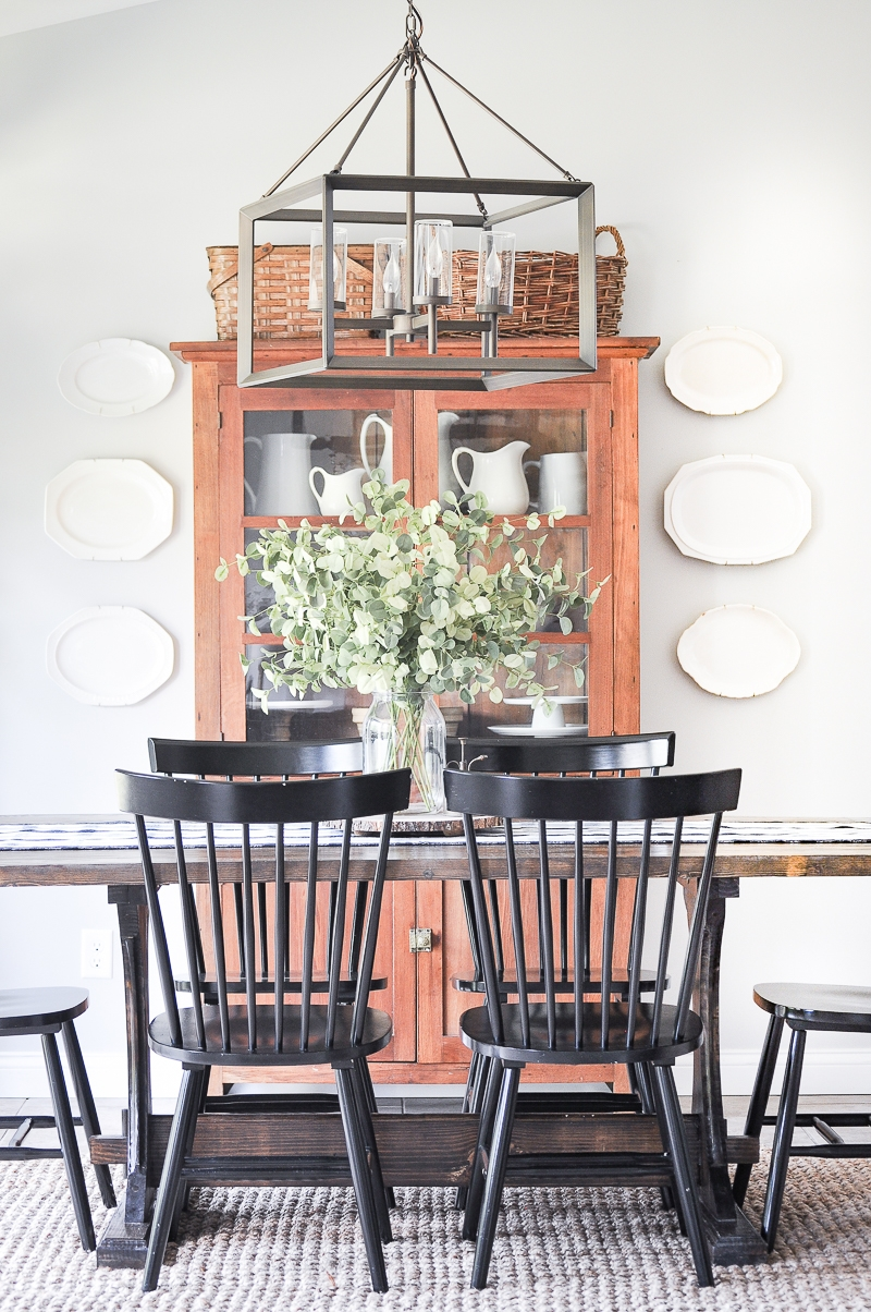 This china cabinet fits right in with this farmhouse style dining room
