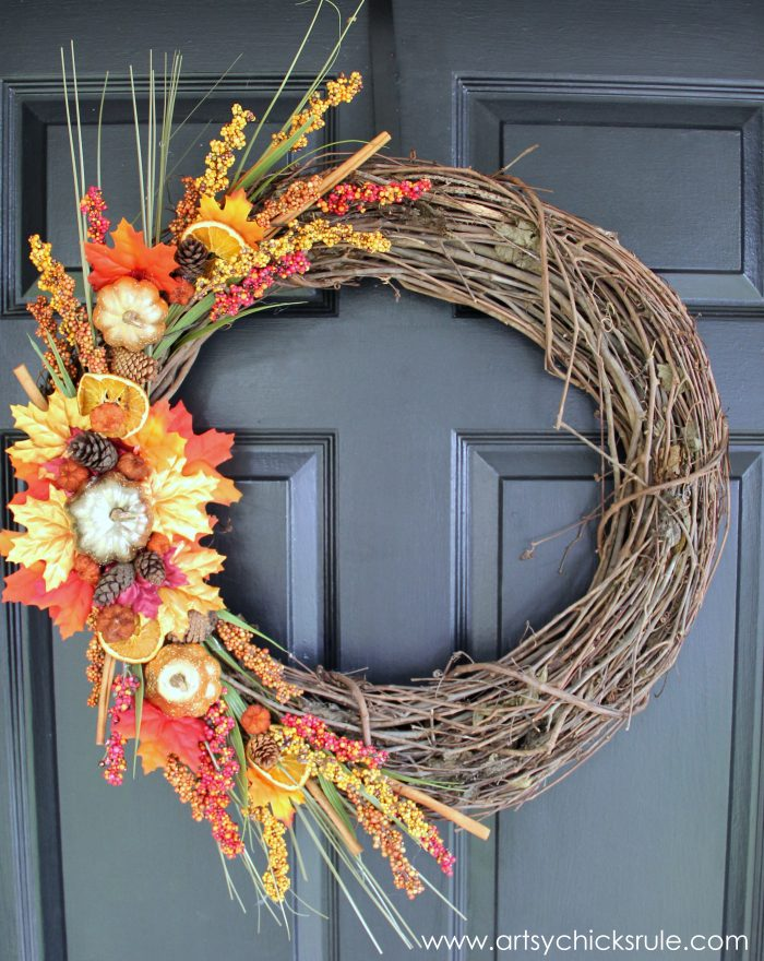 The metallic pumpkins on this DIY wreath compliment the sticks.