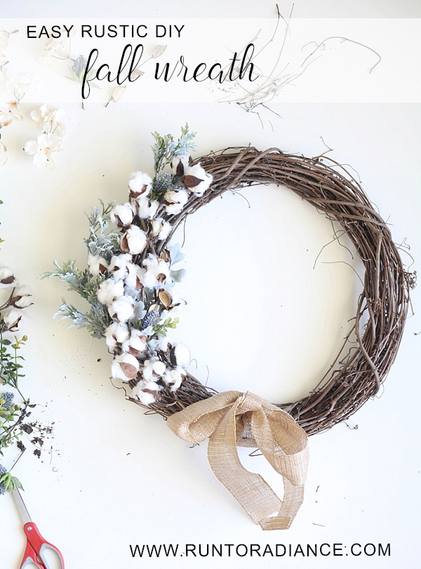 This DIY wreath with cotton, sticks, and greenery is rustic for fall.