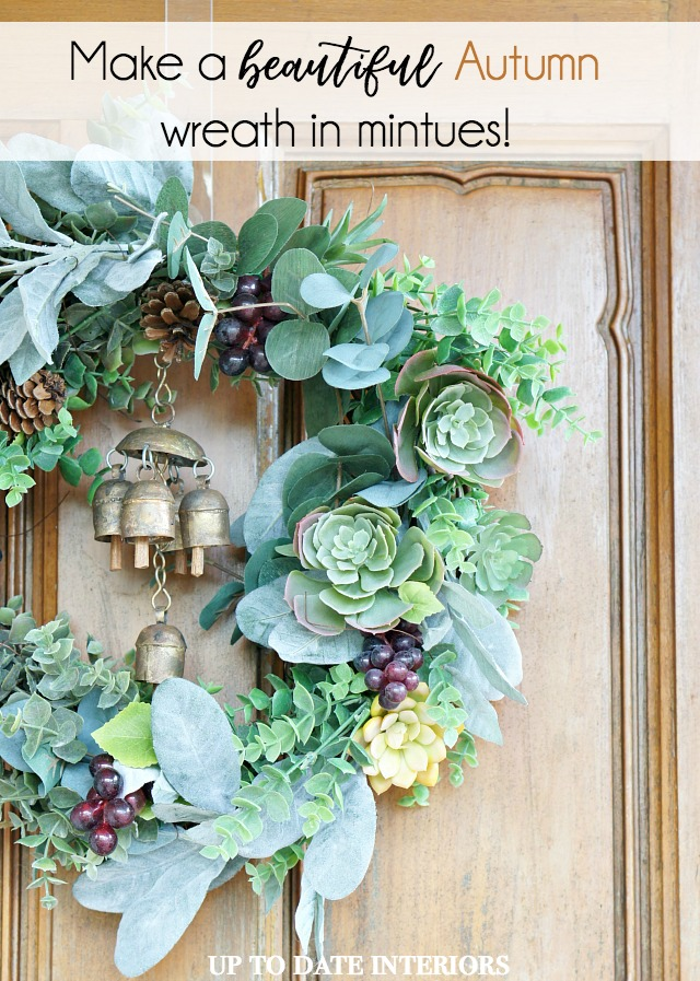 This fall wreath filled with greenery, succulents, and grapes pops against the door.