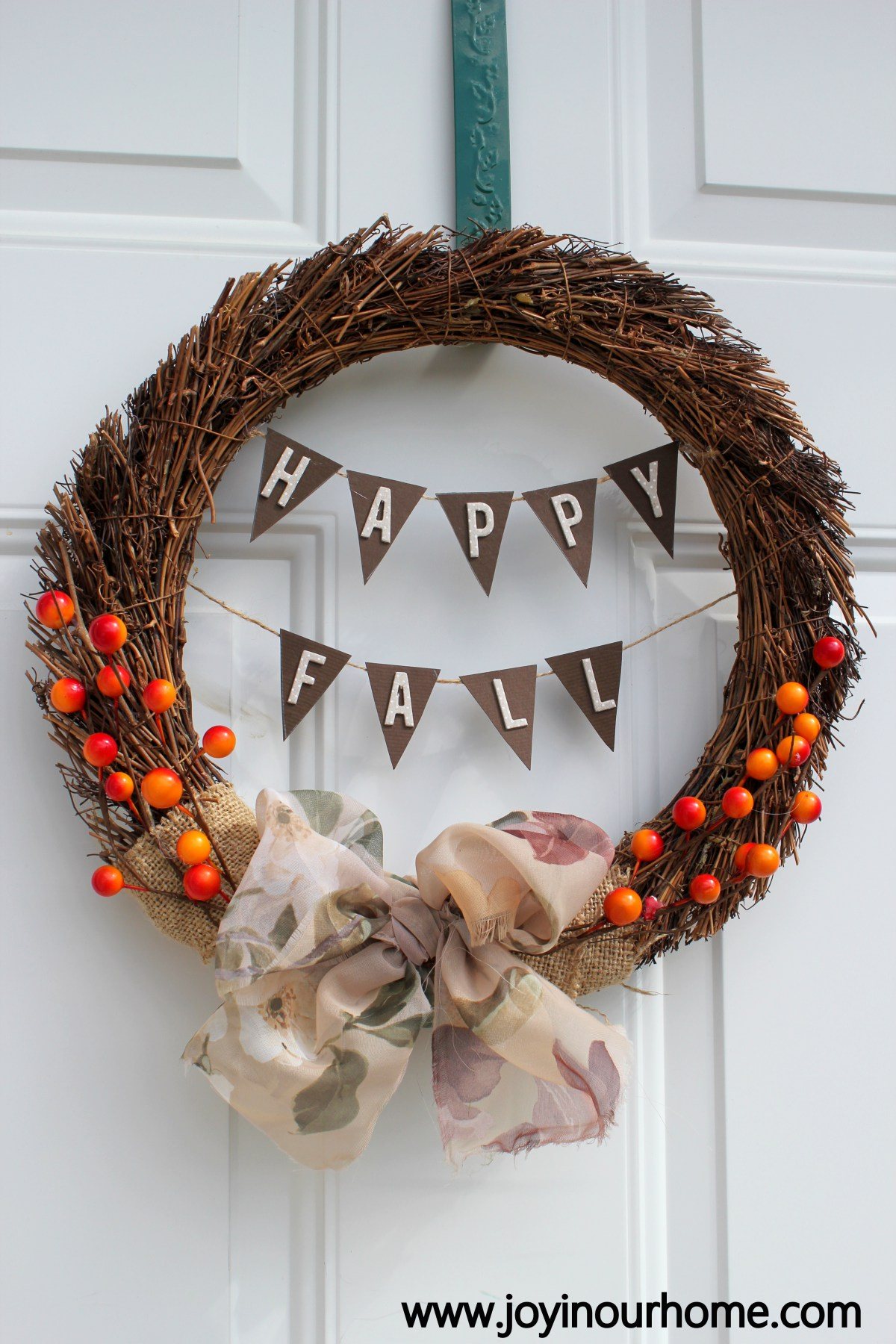 This fun autumn wreath with a happy fall banner is decorative for the season.