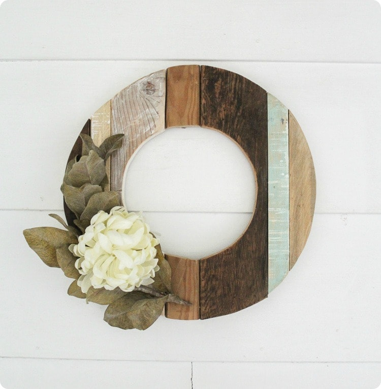 This one of a kinds wooden wreath with just one flower is simple and different.
