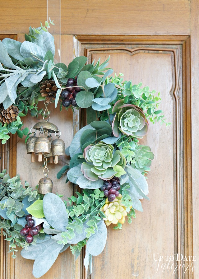The succulents in this wreath work well with the pine cones throughout.